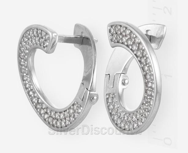Серьги с виде кругов с россыпью камней фианитов, вид сбоку