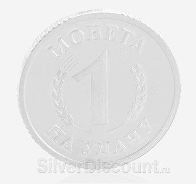 Обратная сторона сувенирной монеты с обезьяной